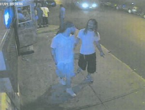 Prosecutors say this surveillance photo shows Shaheed Brown (left) and Enrico Smalley Jr. minutes before Smalley was gunned down outside of La Guira Bar on July 12, 2014.