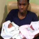 James Austin with his twin daughters