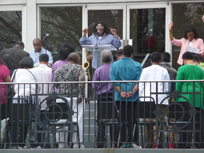 Residents gather for a prayer service on the steps of Shiloh Baptist Church on May 1, 2014, in observance of the National Day of Prayer.