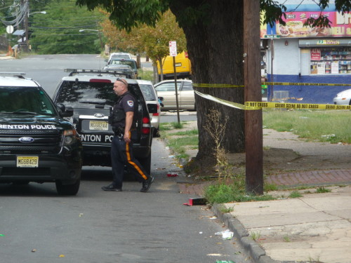 Police investigate a homicide that occurred in an alley in the 100 block of Locust Street. September 13, 2015. (Penny Ray - Trentonian)