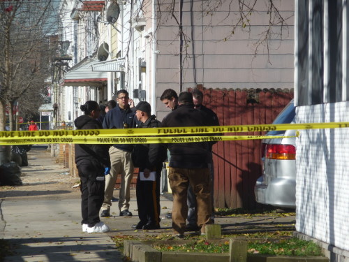Police investigate a murder on Division Street. November 24, 2015  (Penny Ray - Trentonian)