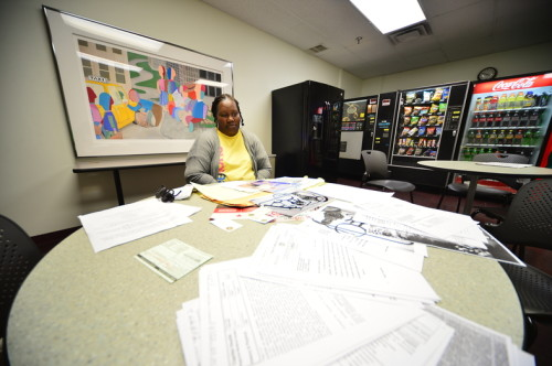 Talaya Greenfield sits before a Trentonian cafeteria table with documents and papers related to her slain son on Nov. 6, 2015 during an interview. (Scott Ketterer - The Trentonian)