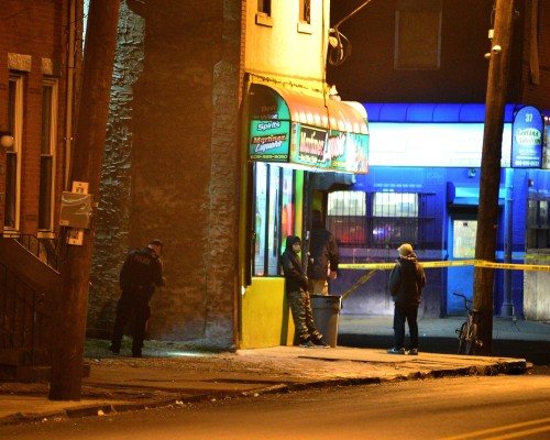 Police investigate a shooting in the area of Chambers Street and Walnut Avenue after a shooting on Saturday evening just after 6 p.m. on Jan. 9, 2016. (Scott Ketterer- The Trentonian)