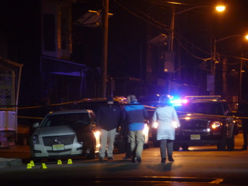 In this file photo, law enforcement investigate a murder in the Wilbur section of Trenton.