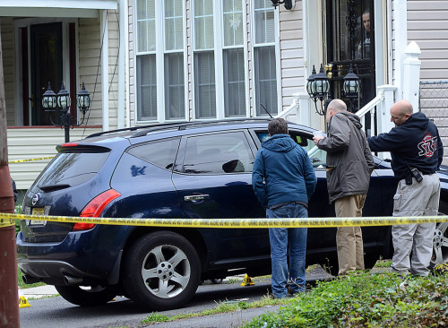Trenton police investigate a murder on Hillcrest Ave in the West Ward. Sources say a man was shot while sitting inside this Nissan Murano. (Gregg Slaboda - Trentonian)
