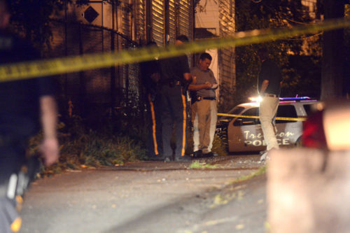 Police investigate a homicide in an alley off the 500 block of Roosevelt Street Friday night.  (John Berry — The Trentonian)