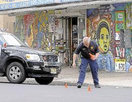 Trentonian file photo - Police investigate a shooting on MLK Boulevard
