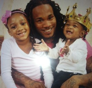 Quaadir Gurley (center) with two of his six children. (Contributed Photo)