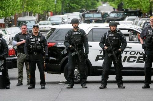 Law enforcement officers at the scene of a standoff on Centre Street in Trenton that ended Thursday, May 11, 2017, after 35 hours with suspect Tyleeb Reese surrendering. (John Berry - The Trentonian)