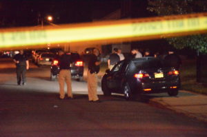 Police investigate a murder in the 100 block of Miller Street. (Penny Ray - Trentonian)