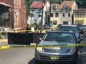 Police and County Homicide detectives on the scene of a murder on Sanford St. in Trenton. John Berry - The Trentonian
