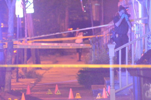 Police investigate a murder in the 800 block of East State Street Sunday night. (Penny Ray - Trentonian)