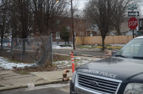 A man died after being shot in a car, which he crashed into this fence on Asbury Street.