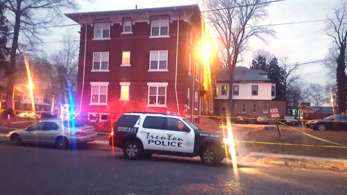 Cops guard the scene of Trenton's first homicide of 2018.
