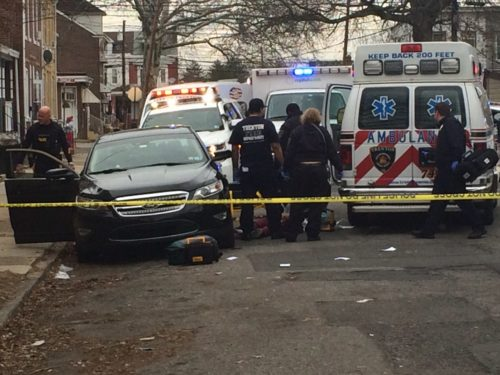 Police investigate a murder in Trenton Monday afternoon.