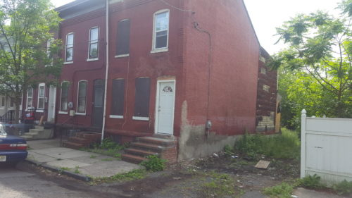 A partially decomposed body was found in an area behind this home on Taylor Street.