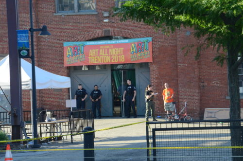 Police investigate a fatal shooting that injured 20 people at the Art All Night celebration in Trenton. (Penny Ray - Trentonian)