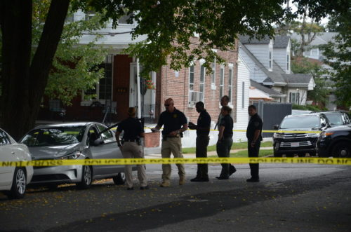 Police investigate a murder on Morris Avenue Saturday morning. (Penny Ray - Trentonian)