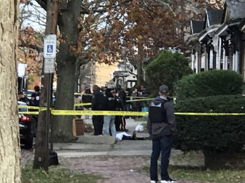 Police investigate the scene of a fatal shooting on the 300 block of Spring Street in Trenton.  Penny Ray - The Trentonian