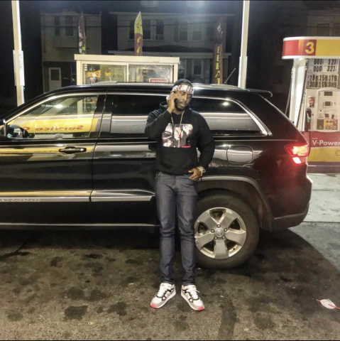 Homicide victim Jamar Tucker of Trenton is seen standing beside his 2012 Jeep Grand Cherokee, which police were looking for on May 11, 2019, as part of their homicide investigation.